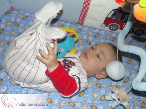 Как отучить ребенка спать только на руках у родителей?